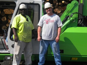 Mill Manager, Chad Cowart (right) with Willie Holt, Operator, with their new  830 R machine.