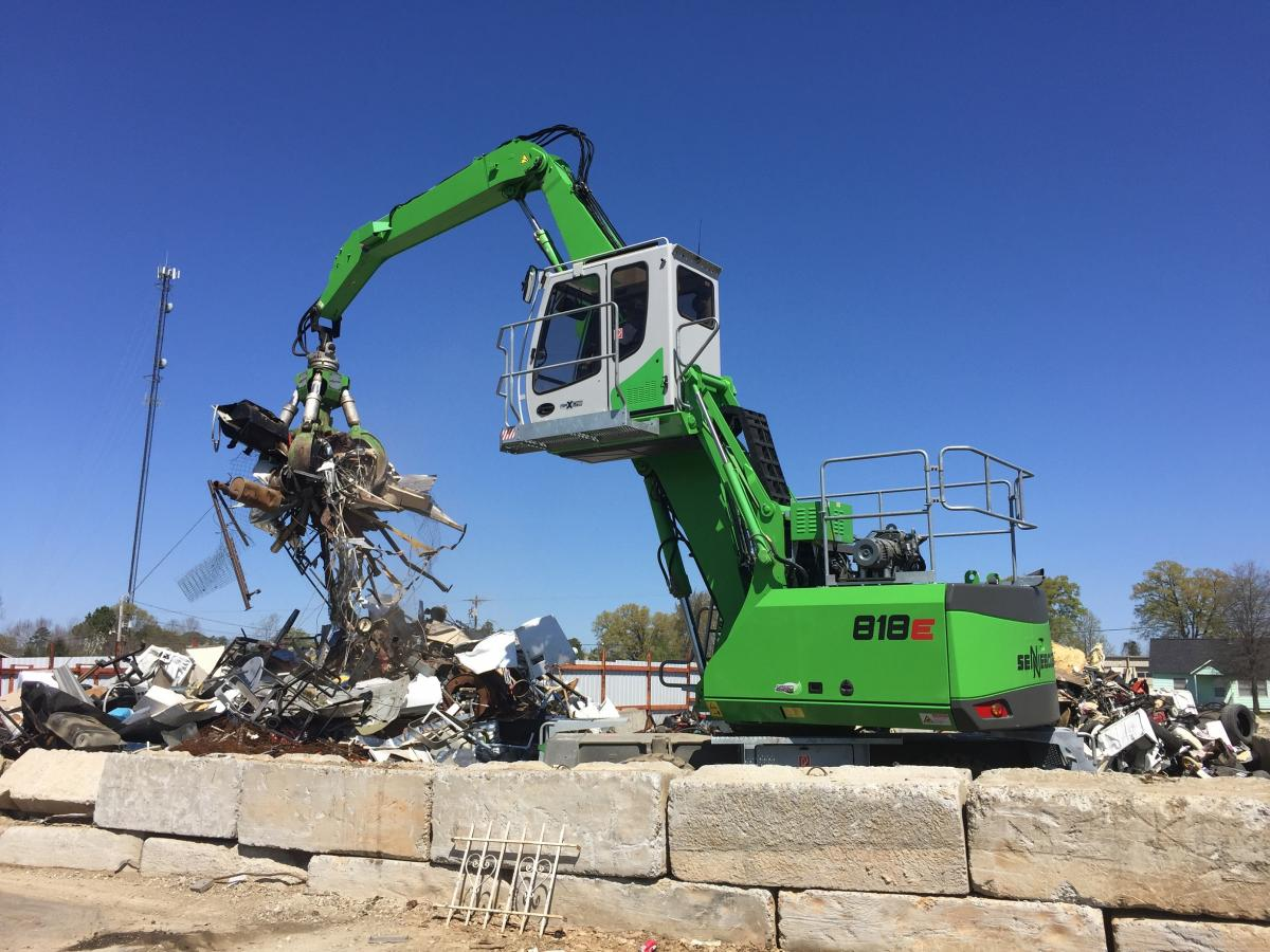The SENNEBOGEN 818, Grapple And Dealer Service Make A Complete Scrap Handling Solution For Palmetto Recycling