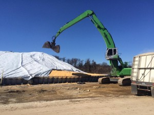 The 840 is ideal for tarping piles by supporting most of the tarp's weight while crews secure it.
