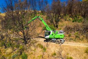 Removing burned out trees from wooded areas is an ideal job for Atlas' 718