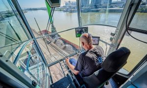 At a height of over 70 ft. (22 m), operators can see perfectly into the ships' hulls while working.